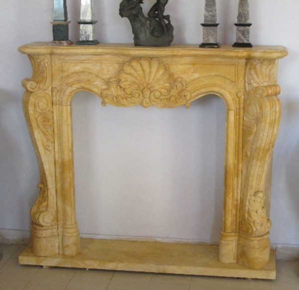 Art 12 fireplace in real yellow marble with an imposing structure but with a simple and essential line that recalls the fireplaces of the French seventeenth century starting from the central shell.