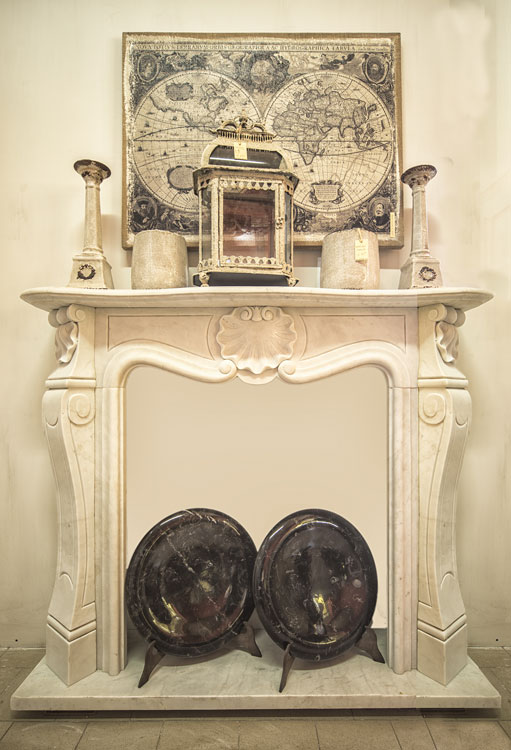 Louis XVI fireplace. The present fireplace is in the most sober and most elegant style, the Louis XVI style, where the rigor of simple and clean geometric lines meet with the simple beauty of the shell without any other decoration to distract the eye from this essential subject. marble is Carrara marble but can also be made with other marbles.