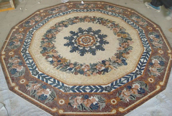 Mosaic developed on a dodecagon, with very small marble tiles depicting flowers arranged in a circle.