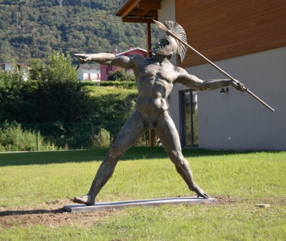 Statue of warrior with javelin, a free interpretation of a warrior with helmet taken in the act of throwing a javelin or a spear and which depicts almost more an athletic than martial gesture.