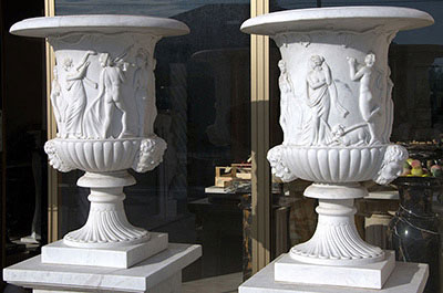 Vases and planters in marble and stone